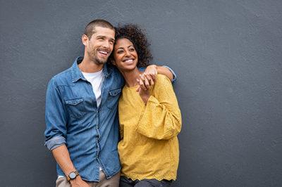 biracial happy, healthy couple arm in arm